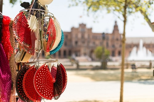 a display of spanish flamenco fans at a marketplace in spain