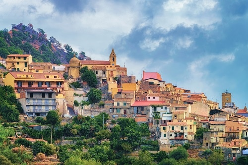 a far view of a savoca village on a mountain in italy