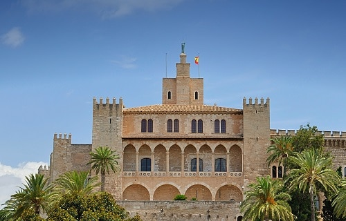 a full view of the royal palace of la almudaina in palma de mallorca