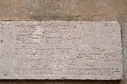 a slab containing glagolitic language in rijeka, croatia
