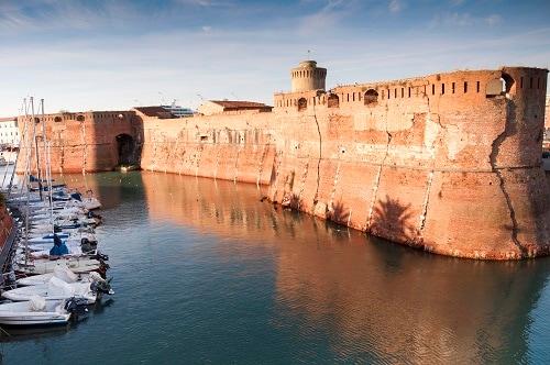 a waterfront view of livorno's fortezza vecchia