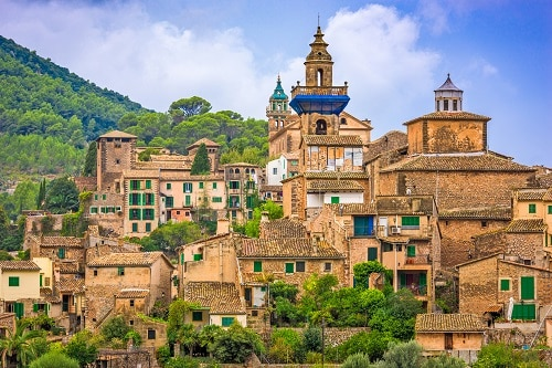 a wide view of the tall buildings of valldemossa, a historic village in palma de mallorca