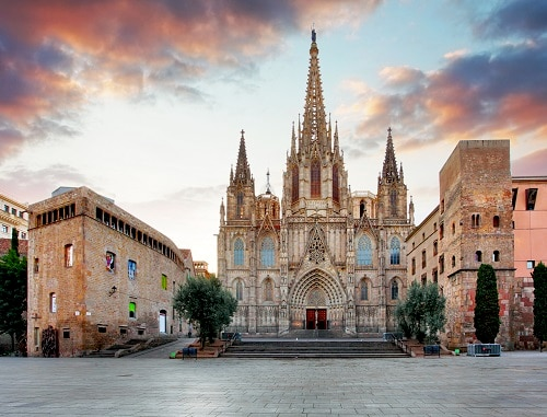 a wide view the cathedral of barcelona at the beginning of sunrise