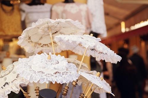 burano lace umbrellas, or parasols, at a marketplace in venice, italy