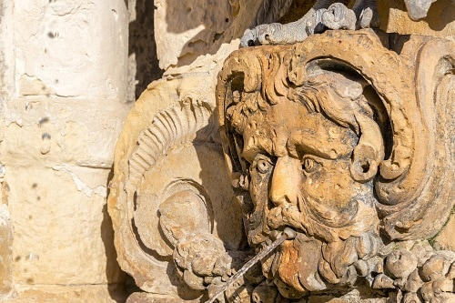 close-up of a fountain in st. george's square, valletta, malta