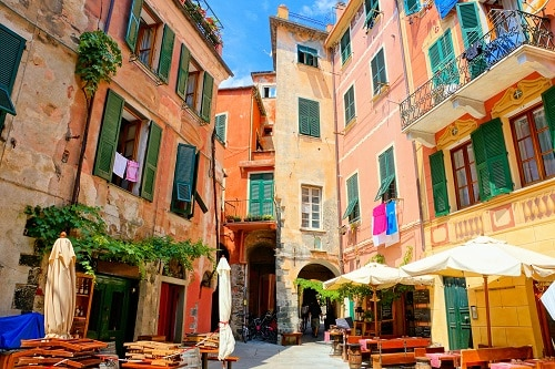 colorful buildings and a narrow walkway in monterosso italy