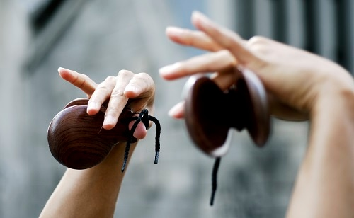 hands of a woman playing flamenco castanets in spain