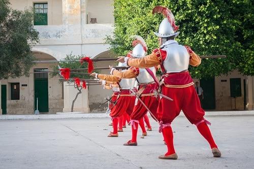 men dressed as knights of malta, practicing 16th-century defense strategies