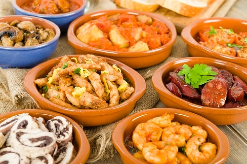 tapas bowls holding different foods from malaga