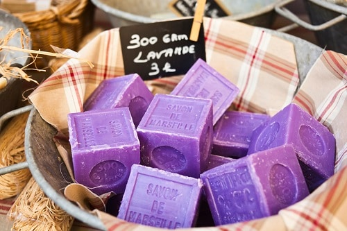 a basket of lavender soap from marseille on display in a street market