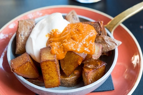 a bowl of patatas bravas