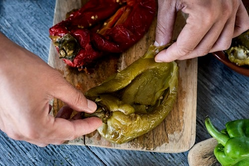 a chef preparing peppers for escalivada