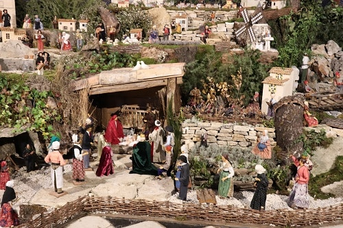 a holiday scene made up of santons from france's provence region