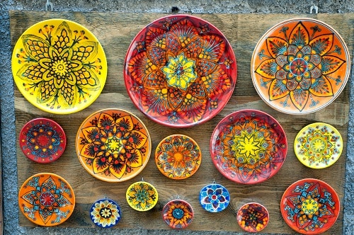ceramic plates for sale along the streets of sicily, italy
