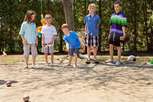 children playing a round of petanque