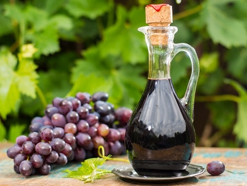 grape vinegar with grapes in the background