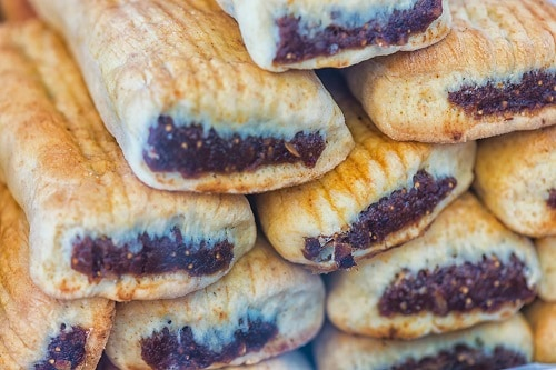 a pile of imqarets, a sweet maltese pastry with date filling