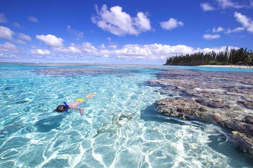 a person snorkeling in mare, pacific islands