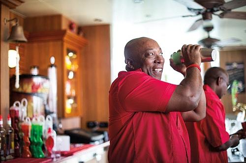 bartender preparing drinks outside at the redfrog rum bar
