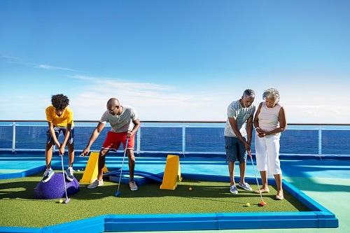 family playing mini golf together