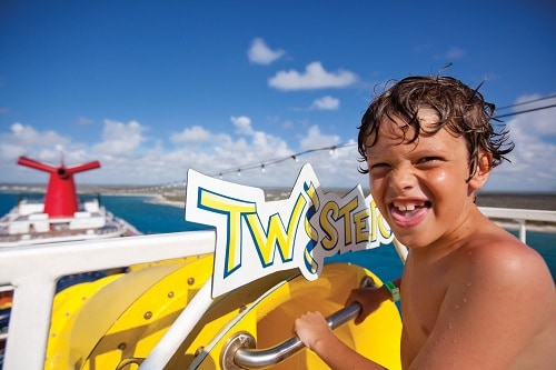 little boy about to go down the twister waterslide