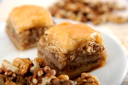 small chunks of baklava on a white plate