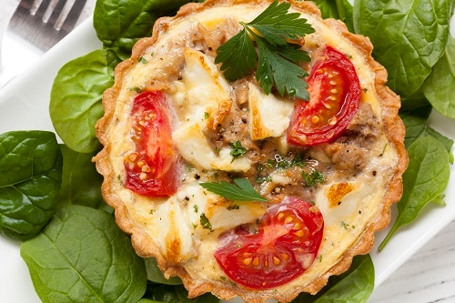 spinach and tuna tart with tomatoes and feta cheese
