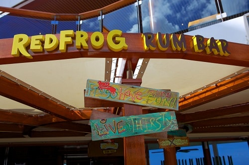 the redfog rum bar sign on a carnival ship
