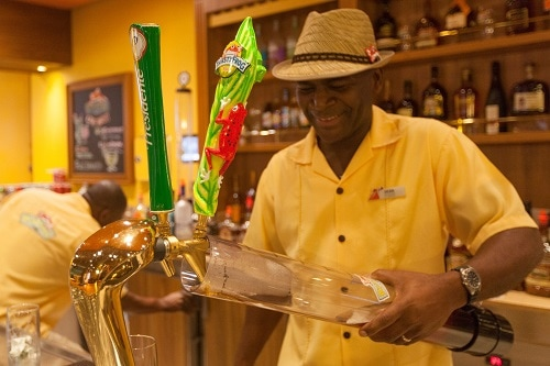 bartender pouring beer into a serving tube