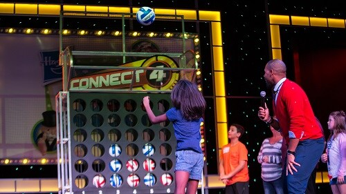 girl playing a round of connect 4 on hasbro, the game show