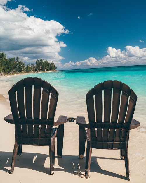 two beach chairs on the beach in freeport