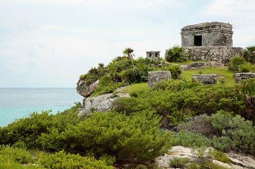 ruins in tulum around lush greenery
