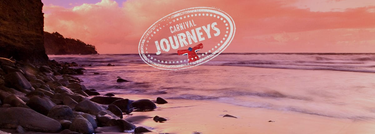 view of beautiful beach destination with carnival journeys logo