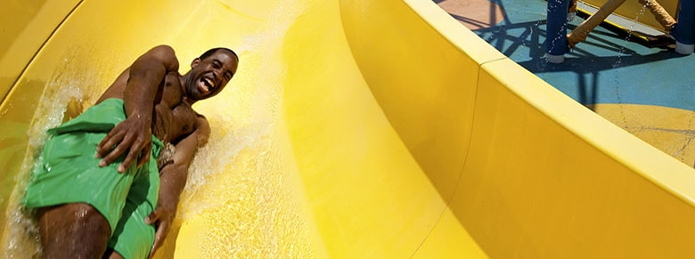 Outdoor Activities - boy going down a slide at waterworks on carnival cruise line