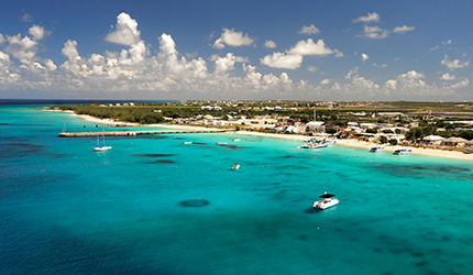 boats lining the water and the beautiful sandy beaches in grand turk