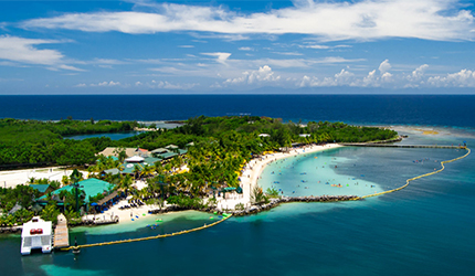 aerial view of mahogany bay and it's turquoise waters