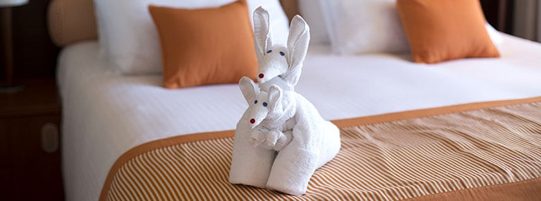 towel animals on the bed in stateroom
