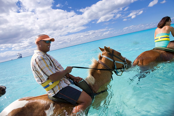One of the best ways to enjoy this tropical island is by horseback right into the surf.