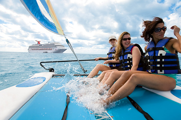 Your catamaran can take you through clear blue waters around Half Moon Cay.