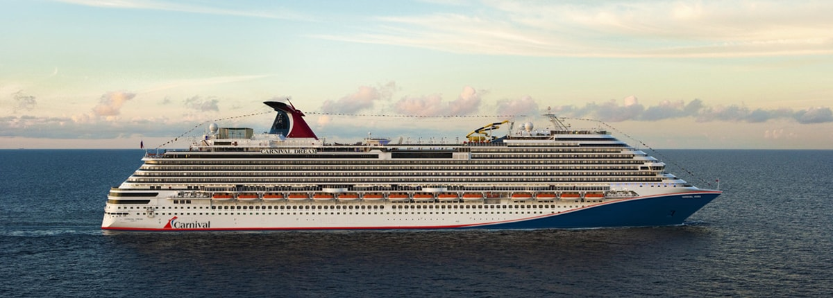 cruise ship carnival dream sailing through the blue ocean during sunset