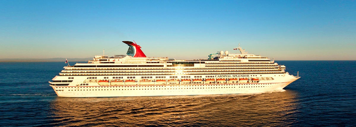 cruise ship carnival splendor sailing through the blue ocean with the sun gleaming on her