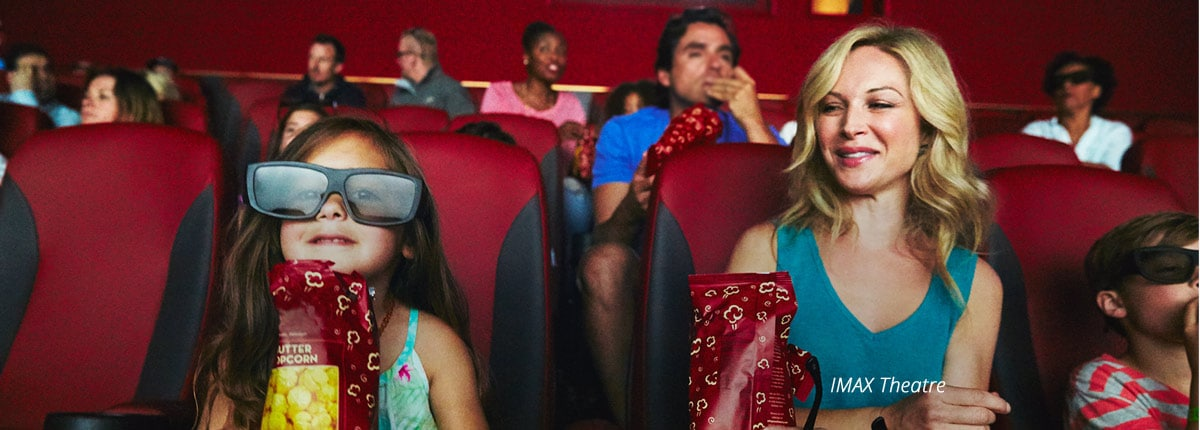 mom and daughter enjoy a moive at the imax theatre on vista