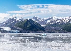 A view of snow capped mountains by Hubbard Glacier