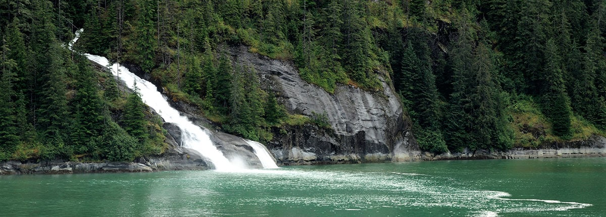 gorgeous view of mountain waterfalls in tracy arm fjord