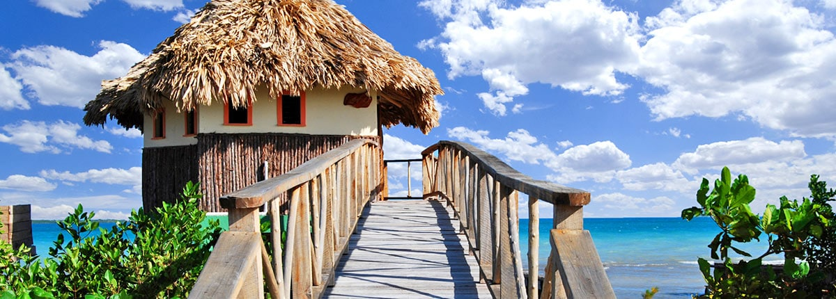 tiki hut in belize overlooking ocean