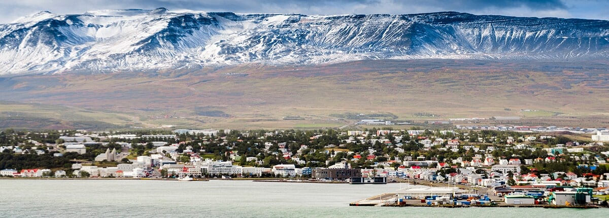 view of akureyri city in iceland with mountains in the background