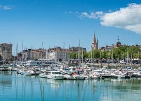 the old harbor of la rochelle, france lined with sailboats