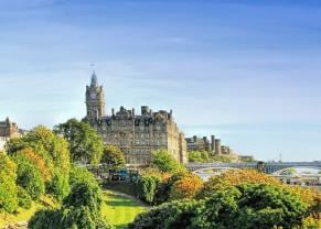 beautiful view of princes street gardens on a bright, sunny day in edinburgh, scotland