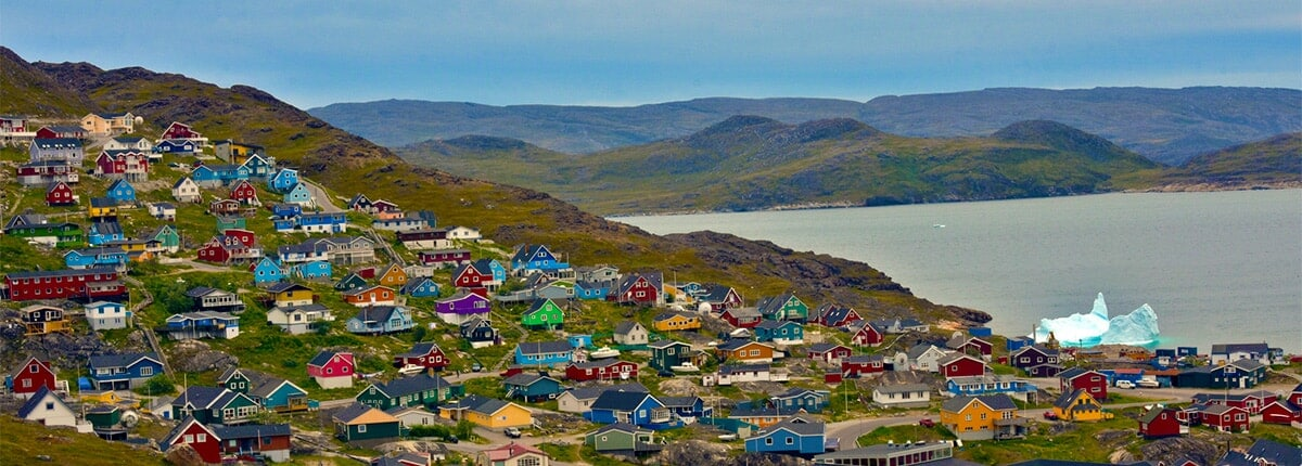 the town of qaqortoq nestled among the mountains