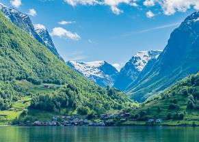 view of the town and green mountains from sognefjord